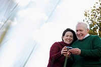 Couple looking at a digital camera and smiling