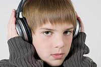 Close_up of a boy listening to music