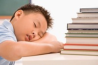 Close_up of a schoolboy napping in a classroom