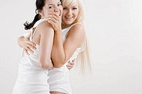 Portrait female homosexual couple embracing each other and smiling