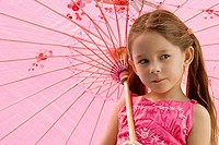 Close_up of a girl holding an umbrella