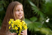 Close_up of a girl holding a bunch of flowers and smiling