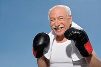 Close_up of a senior man in boxing pose