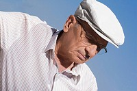 Close_up of a senior man wearing a flat cap