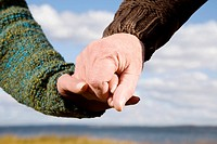 Close_up of a couple holding hands of each other