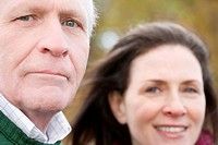 Portrait of a senior man with a mature woman smiling behind him (thumbnail)