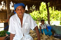 Portrait of a mature man with his wife in the background, Papantla, Veracruz, Mexico
