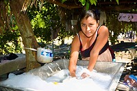Portrait of a young woman washing clothes, Papantla, Veracruz, Mexico