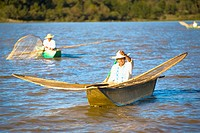 Fishermen with butterfly fishing nets in a lake