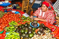 Mid adult woman selling vegetables, Tlacolula De Matamoros, Oaxaca State, Mexico