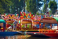 Two men on a trajineras boat, Xochimilco Gardens, Mexico City, Mexico