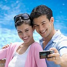 Close_up of a young couple taking a picture of themselves