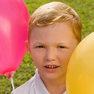 Portrait of a boy with balloons
