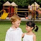 Close_up of a boy and a girl looking at each other