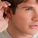 Close_up of a young man listening