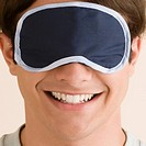 Close_up of a young man wearing an eye mask