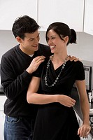 Young couple smiling in the kitchen