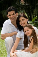 Portrait of a young couple with their daughter in a park