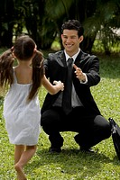 Young man looking at his daughter and smiling