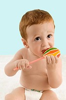 Close_up of a boy licking a lollipop