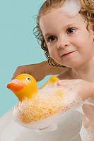 Close-up of a girl holding a rubber duck and smiling (thumbnail)
