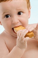 Close_up of a boy eating a toast
