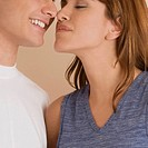 Close-up of a young couple rubbing their noses (thumbnail)