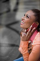 Side profile of a young woman talking on a mobile phone