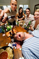 Young woman with her friends enjoying a party (thumbnail)