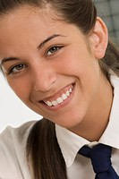 Portrait of a teenage girl smiling (thumbnail)