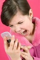 Close_up of a girl holding a mobile phone