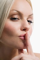 Portrait of a young woman with her finger on her lips (thumbnail)