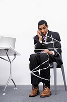 Businessman trapped in a wire of a telephone