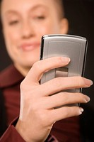 Close-up of a businesswoman text messaging (thumbnail)