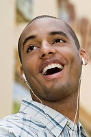 Close_up of a young man listening to music
