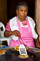 Portrait of a senior woman cooking, Cuetzalan, Puebla State, Mexico