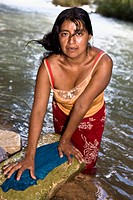 Portrait of a mid adult woman washing clothes, Agua Azul Cascades, Chiapas, Mexico