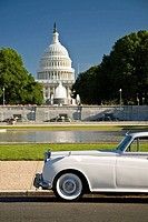 USA, Washington, D.C. A Rolls Royce sits parked in front of the capital building