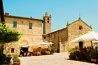 Sidewalk cafe in front of a church, Romanesque Church, Piazza Roma, Monteriggioni, Siena Province, Tuscany, Italy