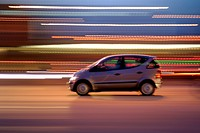 Fast driving car in the evening rush-hour, Kiel, Schleswig-Holstein, Germany