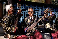 The Naxi orchestra pracisting by the Black Dragon Pool, Lijiang, Yunnan province, China, Asia