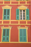 Exterior of a formal facade, brightly painted, with blue shutters and orange walls, Ajaccio, island of Corsica, France, Mediterranean, Europe
