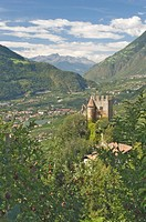 View from Dorf Tyrol of the 13th century Brunnenburg Castle, once the home of Ezra Pound and now a museum, and the valley towards the Reschen Pass and...
