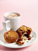 Raspberry muffins and cup of coffee