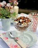 Granola with yoghurt in a stemmed dessert glass