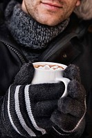 Man holding hot chocolate