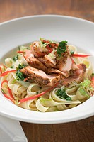 Ribbon pasta with fried peppered salmon and red pepper