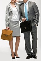 Businessman and businesswoman carrying briefcase