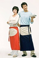 Young couple wearing apron