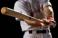 Close up of baseball player swinging bat